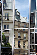 window reflection of Paris apartments in modern glass shopping mall Les Halles