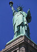 Looking up at the Statue of Liberty, mid day with blue skies