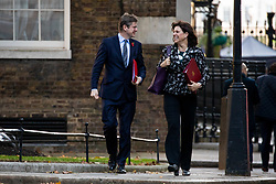 © Licensed to London News Pictures. 29/10/2018. London, UK. Secretary of State for Business, Energy and Industrial Strategy Greg Clarke and Energy and Clean Growth Minister Claire Perry arriving in Downing Street for a cabinet meeting, ahead of the Chancellor of the Exchequer Philip Hammond's autumn budget statement this afternoon. Photo credit : Tom Nicholson/LNP