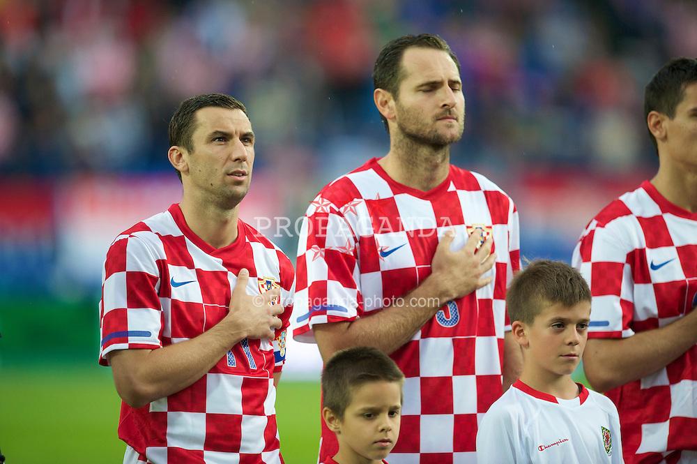 OSIJEK, CROATIA - Sunday, May 23, 2010: Croatia's captain Darijo Srna and Josip Simunic before the International Friendly match against Wales at the Stadion Gradski Vrt. (Pic by David Rawcliffe/Propaganda)