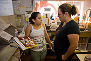 Lourdes Alvarez speaks to her daughter in the kitchen of her Mexican restaurant El Coyote, in the suburb of Alsip, Chicago.  (Lourdes Alvarez is featured in the book What I Eat;  Around the World in 80 Diets.)   MODEL RELEASED.