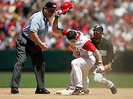 The Anaheim Angels' Adam Kennedy shows his frustration at being called out second during the Angels 2-1 victory over the Florida Marlins Saturday June 18, 2005 at Angel Stadium.