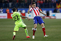 Atletico de Madrid´s Siqueira (R) and Barcelona´s Dani Alves during Copa del Rey `Spanish King Cup´ soccer match at Vicente Calderon stadium in Madrid, Spain. January 28, 2015. (ALTERPHOTOS/Victor Blanco)