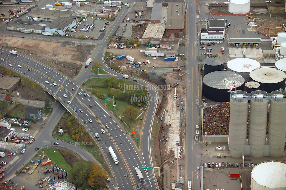 New Haven I-95 I-91 Interchange Pre-Load CT-DOT 92-581 Aerial Photography. View shows nearby Oil Storage Tanks and Delivery Rack, Concrete storage Silos, and Railroad Tracks under construction.