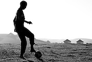 Kids from the local village  of Nqileni kick around a soccer ball donated by Adidas. Nqileni is one of the most remote, poorest villages in South Africa. Being able to play football (soccer) keeps the kids stimulated and healthy. Picture by Greg Beadle Images portraying the life led by locals of 'The Wild Coast' region of South Africa. Rugged terrain spans the Eastern Sea Board, the seas teeming with aquatic life. Images by Greg Beadle