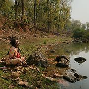 A woman prays to water  in Madya Pradesh.