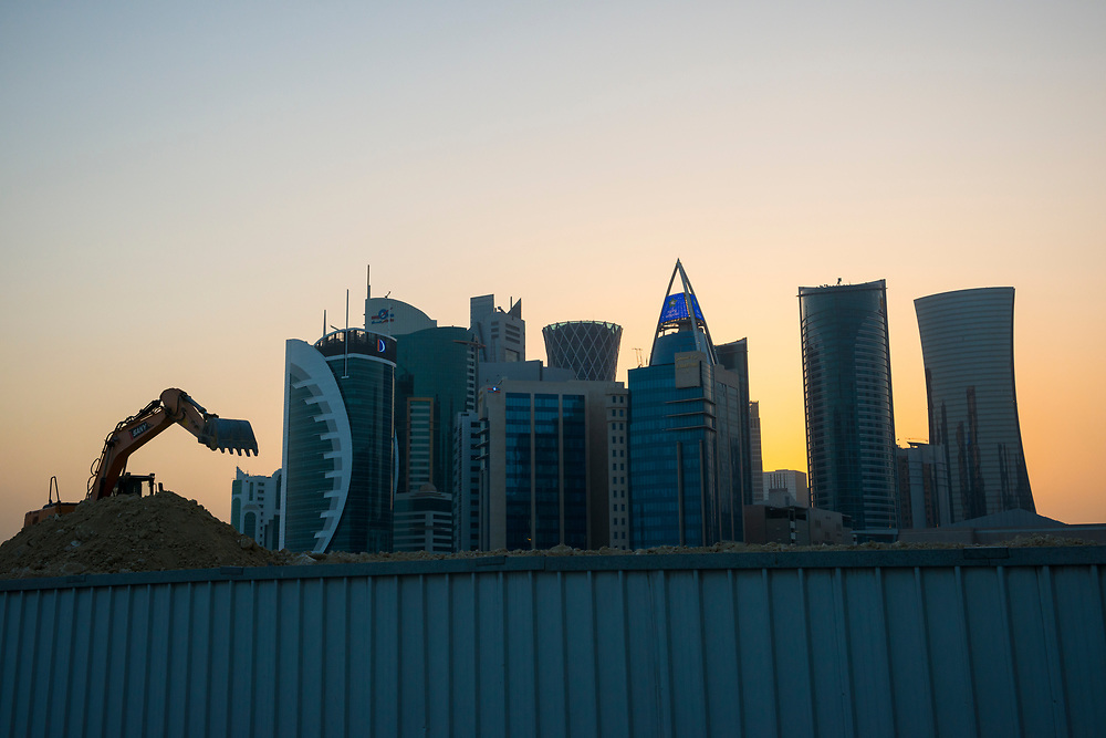 The bucket of a backhoe marks the spot of another construction site in Doha, Qatar.