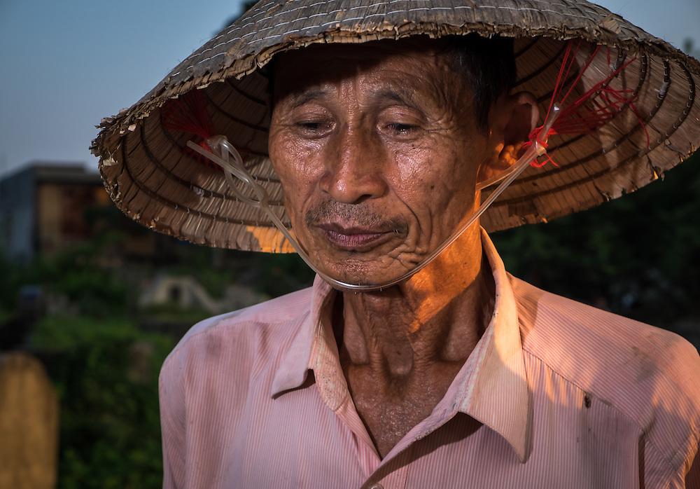 VAN HA, VIETNAM - CIRCA SEPTEMBER 2014: Farmer at the Lang Gom Tho Ha village. The village belongs to the Van Ha commune, it is located 50km away from Hanoi in Northern Vietman