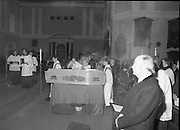 Funeral Of Frank Duff.   (N50)..1980..13.11.1980..11.13.1980..13th November 1980..The Solemn Funeral Mass for Frank Duff, founder of The Legion of Mary,was concelebrated with his Eminence,Cardinal Tómas O'Fiaich,Archbishop of Armagh and Primate of All Ireland as principal celebrant, at St Andrew's Church, Westland Row,Dublin. The funeral took place after the mass to Glasnevin Cemetery..Smoke from the incense burner fills the air at the funeral mass of Frank Duff in St Andrew's Church.