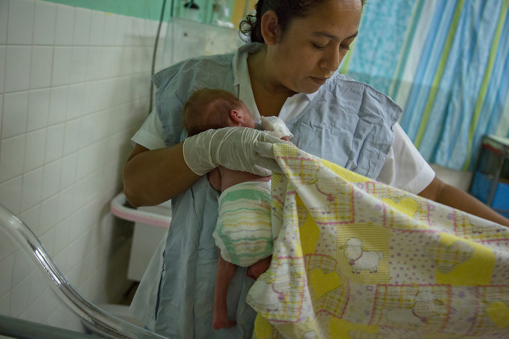 A premature baby born of young teenage parents Daylin, 15, and Rubin, 17, is cared for in the neonatal ICU of Hospital San Benito.