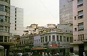 Street view with older buildings near the docks in Rio de Janeiro, Brazil 1962 street car tram