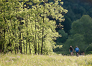 Cyclists in the countryside at La Cluse-et-Mijoux, Jura region, France