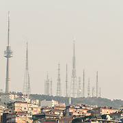 A cluster of radio towers stand on the ridge on the Asian side of Istanbul.