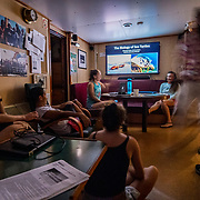 Sea Turtle scientists Alexandra Gulick and Nerine Constant give a talk in the ships lounge. The Greenpeace ship Esperanza during its expedition to the Sargasso Sea, a unique region in the North Atlantic Ocean that is home to a diverse array of marine life, including loggerhead and green sea turtles.  The journey will see Greenpeace and University of Florida researchers team up to study the impact of plastics and microplastics on marine life and the importance that the Sargasso's drifting Sargassum seaweed habitat has for the development of juvenile sea turtles.