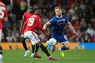 Rochdale's Callum Camps tackled by Manchester United's Aaron Wan-Bissaka during the EFL Cup match between Manchester United and Rochdale at Old Trafford, Manchester, England on 25 September 2019.