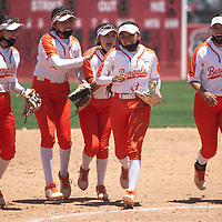 Gallup Bengals congratulate Katherine Lincoln (3) after she makes a diving play to throw the runner out at first base ending the inning during their NMAA Class 4A Softball State Championship game against the Artesia Bulldogs Saturday in Albuquerque.