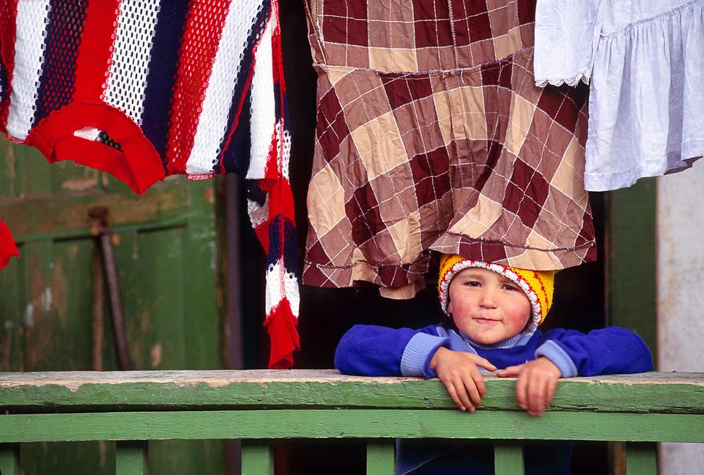 Playful child, Village of Sireniki, summer, Chukotsk Peninsula, Northeast Russia
