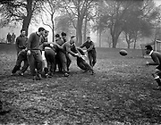 In spite of the frozen conditions of the ground at College Park, Dublin, the South African team were early on the pitch for practice,.A Malan the Captain, getting the pass to A P Baard,..Irish Rugby Football Union, Ireland v South Africa, Tour Match, South African team practice, College Park, Dublin, Ireland, Thursday 15th December, 1960,.15.12.1960, 12.15.1960,..South African Team, ..L G Wilson, Wearing number 15 South African jersey, Full Back, Western Province Rugby Football Club, Cape Town, South Africa, ..AN Other, Wearing number 13 South African jersey, Left Wing, ..A I Kirkpatrick, Wearing number 12 South African jersey, Left Centre, Orange Free State Rugby Football Club, Bloemfontein, South Africa, ..J L Gainsford, Wearing number 11 South African jersey, Right Centre, Western Province Rugby Football Club, Cape Town, South Africa, ..J P Engelbrecht, Wearing number 14 South African jersey, Right Wing, Western Province Rugby Football Club, Cape Town, South Africa,..K Oxlee, Wearing number 10 South African jersey, Stand Off, Natal Rugby Football Club, Durban, South Africa,..R J Lockyear, Wearing number 9 South African jersey, Scrum Half, Griqualand West Rugby Football Club, Kimberley, South Africa, ..S P Kuhn, Wearing number 1 South African jersey, Loose Head Prop, Transvaal Rugby Football Club,  Johannesburg, South Africa,..R A Hill, Wearing number 2 South African jersey, Hooker, Rhodesia Rugby Football Club, Rhodesia, Zimbabwe,..P S du Toit, Wearing number 3 South African jersey, Tight Head Prop, Boland Rugby Football Club, Wellington, South Africa, ..A S Malan, Wearing number 4 South African jersey, Captain of the South African team, Lock, Transvaal Rugby Football Club,  Johannesburg, South Africa,..J T Claassen, Wearing number 5 South African jersey, Lock, West Transvaal Rugby Football Club,  Johannesburg, South Africa,..G H Van ZYL, Wearing number 6 South African jersey, Flank, Western Province Rugby Football Club, Cape Town, South Africa, ..H J M Pelser, W