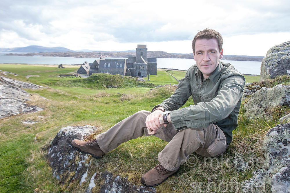 Historian Ashley Cowie digs near Iona Abbey, on Iona during his road trip. He is doing a seven part series for The Scottish Sun on Scotland's treasure hunts at the end of April..©Michael Schofield..