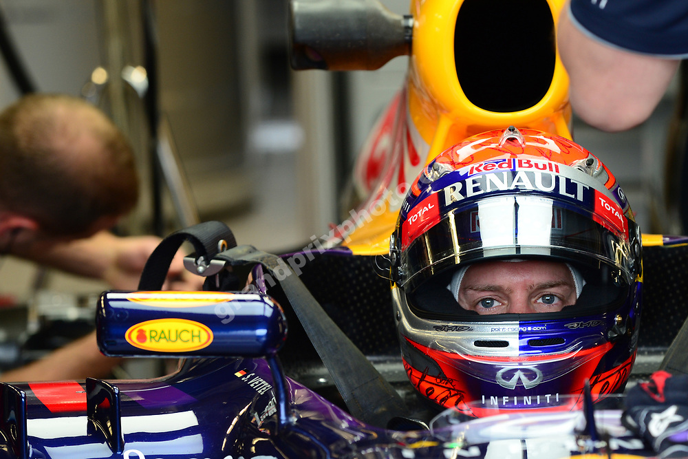 Sebastian Vettel (Red Bull-Renault) in the pits with his helmet on before practice for the 2013 Canadian Grand Prix at the Ile Notre Dame in Montreal. Photo: Grand Prix Photo