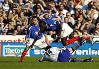 Fotball<br /> Premier League 2004/05<br /> Portsmouth v Everton<br /> 26. september 2004<br /> Foto: Digitalsport<br /> NORWAY ONLY<br /> Amdy Faye goes flying after a tackle from Kevin Kilbane