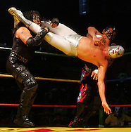 Photo by Alex Jones..El Hijo del Santo sets up to throw Pirata Morgan and El Maniaco with a flying head scissors move during Monday night's fight.