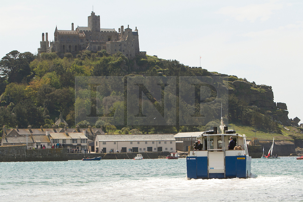 © Licensed to London News Pictures. 17/05/2013. Marazion, UK. Queen Elizabeth II and Duke of Edinburgh are transported to St Michael's Mount on an Amphibious Vehicle. Photo credit : Ashley Hugo/LNP