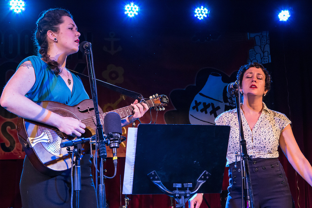 Mamie Minch and Tamar Korn (left to right) singing blues and old time duets at the Brooklyn Follk Festival. Minch is playing a steel guitar.