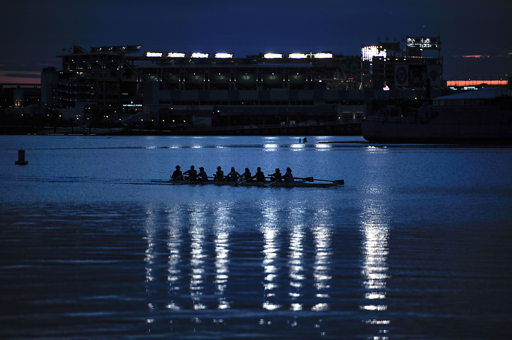 A group of rowers are silhouetted by the lights of the Nationals baseball stadium on the Anacostia River in Southeast Washington.