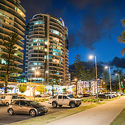 "The beachfront park (Queen Elizabeth Park) at Tweed Heads-Coolangatta at night. Sometimes paired as ""Twin Towns,"" Coolangatta and Tweed Heads, on the southern end of the Gold Coast, straddle the Queensland-New South Wales border."
