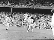 Roscommon jumps high and grabs the ball as Armagh tackles him from below during the All Ireland Senior Gaelic Football Semi Final Replay Roscommon v Armagh in Croke Park on the 28th August 1977. Armagh 0-15 Roscommon 0-14.