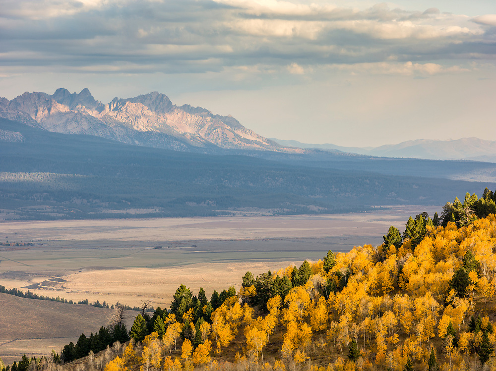 Autumn Color comes to the Sawtooth Valley in early morning light with the Sawtooth Mountain Range near Stanley Idaho. Licensing and Open Edition Prints.