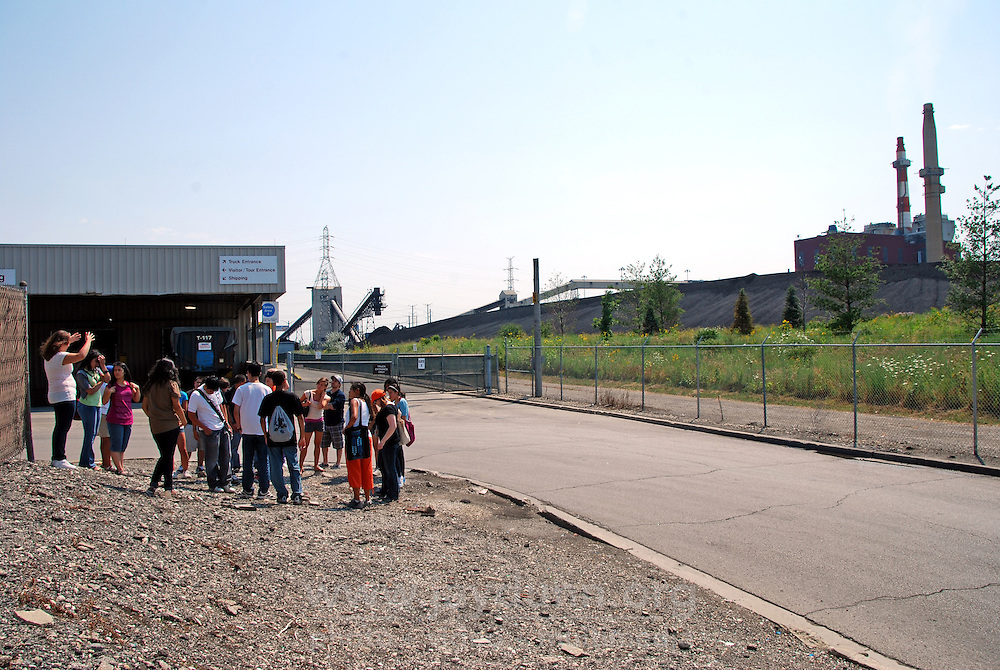 """USA, Chicago, August 25, 2009.  A """"toxic tour"""" for willing participants finishes up at one of Little Village's two coal plants. The Little Village Environmental Justice Organization, headquartered in a predominantly Mexican-American neighborhood of Chicago, campaigns not only against pollution but for clean power, park facilities, urban agriculture, and restoring public transit. LVEJO's staff and volunteers make significant outreach and education efforts, especially for youth. Photo for an HOY feature story by Jay Dunn."""