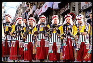 The Ligeros, a Moorish army, march with picks on shoulders at Moors & Christians fest; Alcoy. Spain