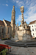 The Holy Trinity Statue and the Goat's Church (Kecske templom )- Fo Square (F? Ter) - Sopron, Hungary .<br /> <br /> Visit our HUNGARY HISTORIC PLACES PHOTO COLLECTIONS for more photos to download or buy as wall art prints https://funkystock.photoshelter.com/gallery-collection/Pictures-Images-of-Hungary-Photos-of-Hungarian-Historic-Landmark-Sites/C0000Te8AnPgxjRg