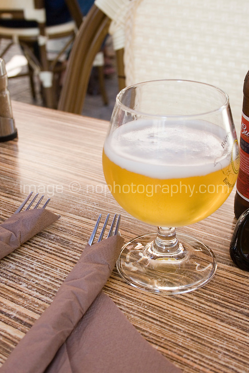 Glass of beer on a restaurant table in Antibes the South of France