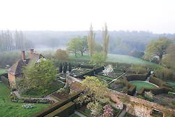 View from the Tower at Sissinghurst Castle at dawn showing the South Cottage, the Rose Garden and the Cottage Garden