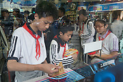 Children getting fastfood from shop after school, French Concession, Shanghai