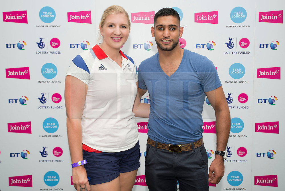 © Licensed to London News Pictures. 19/07/2013. London, United Kingdom.  Olympic Hero Rebecca Adlington back on the Olympic Park with boxer Amir Khan at Go Local - the UK's largest ever celebration of volunteering at Queen Elizabeth Olympic Park. Photo credit : Justin Setterfield/LNP