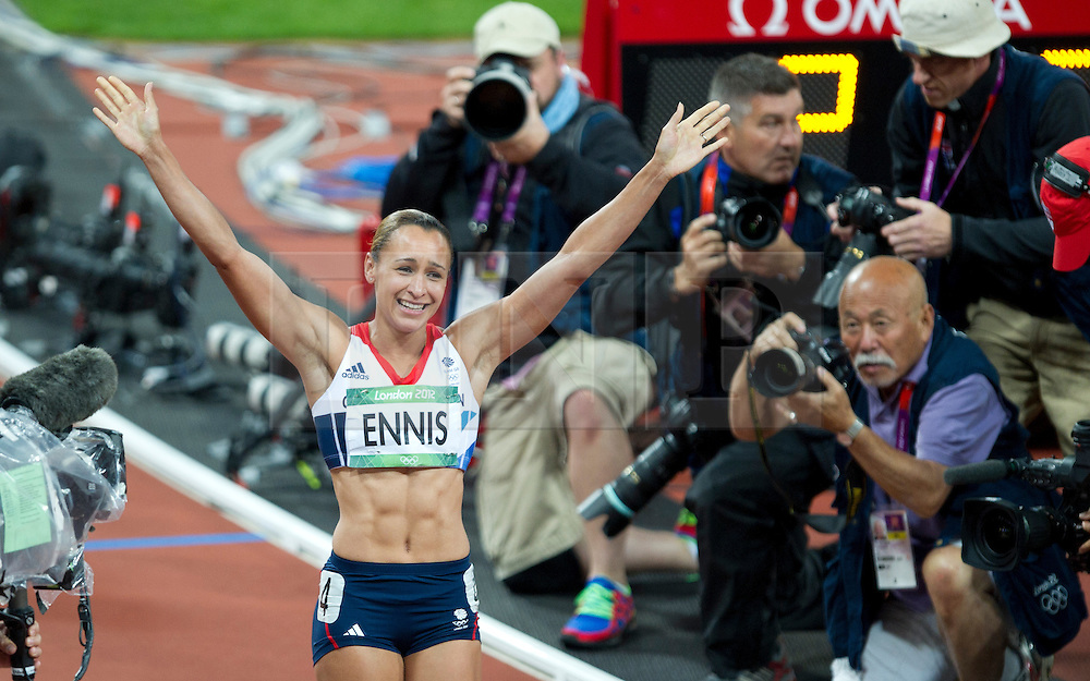 © Licensed to London News Pictures. 06/06/2012. London,Britain.Jessica Ennis celebrates at the end of the 800m race, winning the gold medal in the Women's Heptathlon, at the Olympic Stadium, in London, during the London 2012 Olympic Games .  Photo credit : Bogdan Maran/LNP/BPA