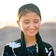Portrait of local girl, Flaming Mountains, Silk Route, Turpan, Xinjiang Province, China.