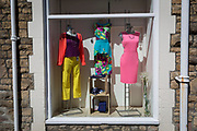 Odd taste of clashing colours in the charity shop window, on 22nd April 2017, in Portishead, North Somerset, England.