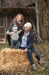 Parents with their little son in the farm, Bavaria, Germany