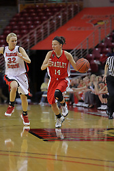 26 February 2009: Flanked by Maggie Krick, Michelle Lund brings the ball up court. The Braves of Bradley  and the Illinois State Redbirds battled it out on Doug Collins Court inside Redbird Arena on the campus of Illinois State University, Normal Il.