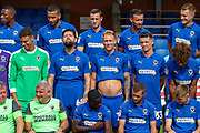 AFC Wimbledon midfielder Anthony Wordsworth (40) and AFC Wimbledon midfielder Mitchell (Mitch) Pinnock (11) messing around in the photo shoot during the official team photocall for AFC Wimbledon at the Cherry Red Records Stadium, Kingston, England on 8 August 2019.