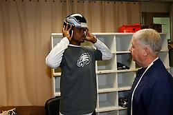 Philadelphia Eagles corner back Nnamdi Asomugha  #24 is fitted for a helmet during the Philadelphia Eagles NFL training camp at Lehigh University on Sunday July 31st, 2011 in Bethlehem, Pennsylvania. (Photo By Brian Garfinkel)