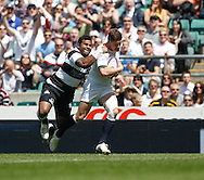 Picture by Andrew Tobin/Tobinators Ltd +44 7710 761829.26/05/2013.Freddie Burns of England is tackled by Takudzwa Ngweyna of the Barbarians during the match between England and the Barbarians at Twickenham Stadium, Twickenham.