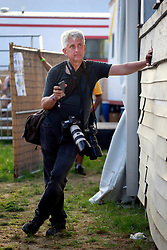 27 April 2013. New Orleans, Louisiana,  USA. .New Orleans Jazz and Heritage Festival. Friend and fellow photographer Skip Bolen..Photo; Charlie Varley.