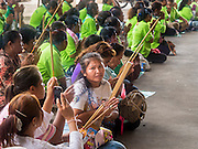 """23 JUNE 2015 - MAHACHAI, SAMUT SAKHON, THAILAND: People pray as the City Pillar Shrine is carried through town in Mahachai. The Chaopho Lak Mueang Procession (City Pillar Shrine Procession) is a religious festival that takes place in June in front of city hall in Mahachai. The """"Chaopho Lak Mueang"""" is  placed on a fishing boat and taken across the Tha Chin River from Talat Maha Chai to Tha Chalom in the area of Wat Suwannaram and then paraded through the community before returning to the temple in Mahachai.   PHOTO BY JACK KURTZ"""