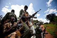 SPLA solider load their guns before traveling through an area recently attacked by the LRA. In the past the north funded the LRA's attacks against the south and it is assumed to be doing so again today.